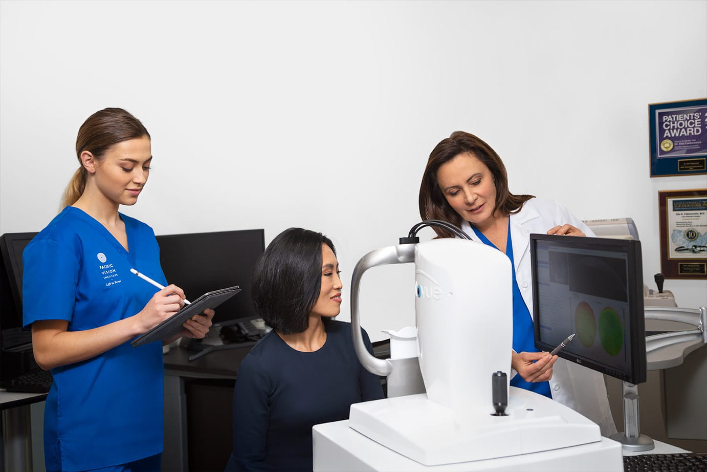 Doctor showing patient images of her eye